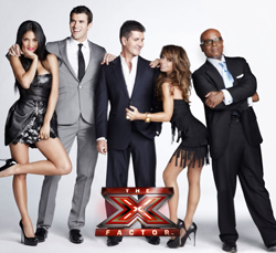Paula Abdul pictured with the judges on the US version of The X Factor